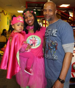 Super Quinn with her Super Mommy and Daddy