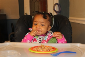 Quinn eating her organic waffles and strawberries