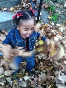 Quinn Having Fun in the Leaves