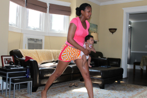 Tanya H. Franklin & Quinn Franklin doing Happy Baby Workout