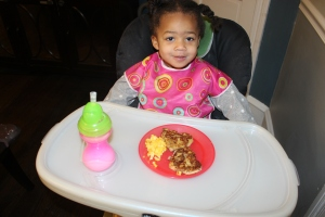 Quinn with her heart shaped French toast and scrambled eggs.