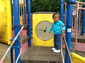 Quinn Playing with the Clock at the Park