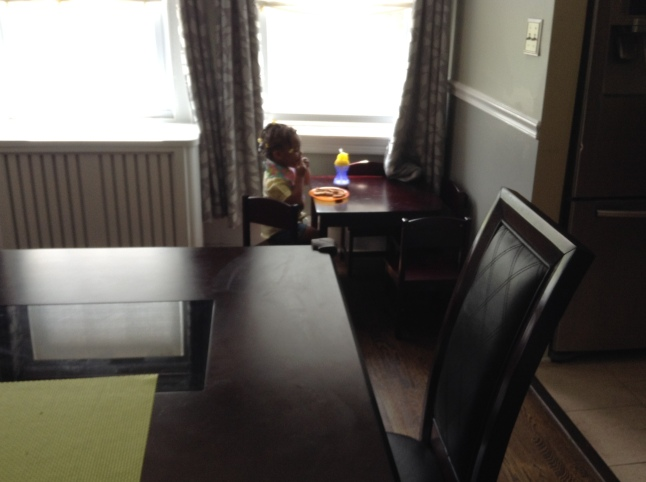 Quinn Sitting Across from the Dining Room Table