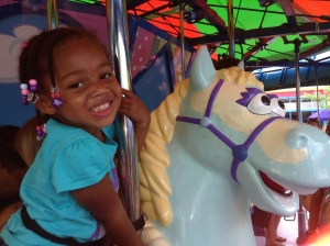 Quinn on her favorite ride: the carousel (or horsey ride as she likes to call it)