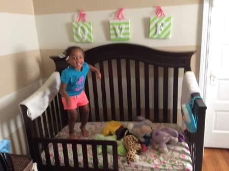 Quinn Jumping Up and Down in Her Toddler Bed