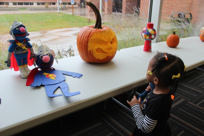 Quinn at the Pumpkin Contest with Super Grover